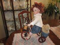 Porcelain doll on bike