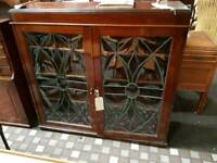 Arts and crafts stained glass bookcase
