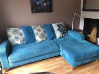 4 seater pillow back chaise end sofa ( right facing) and footstool . Teal colour.