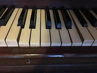 Wilson and Peck upright Piano