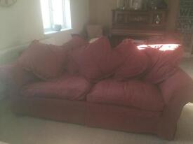 rusty red 3 seater sofa with cushions