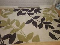 Large plum and green rug