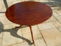 Hand-built, commissioned tilting table, mahogany-stained oak with brass claw feet and castors.