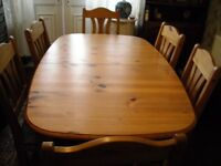 solid pine table set with 6 blue covered chairs in pine