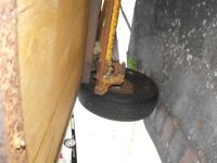 car- trailer , 6ft in length, 4foot width, wooden sides, steel floor, ford axle, no lights attached