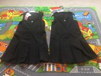 2 new black school pinafores age 5-6