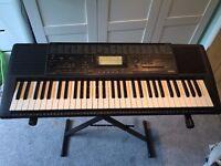 Yamaha PSR 320 electronic keyboard & stand