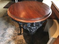 Original round bar table with cast iron base ..