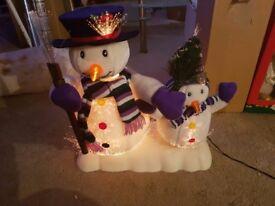 Fibre optic animated snowman pair