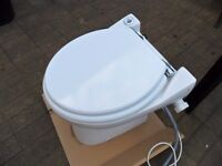 Saniflo Compact macerating toilet in excellent clean working cond as had v little use