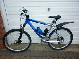 Mens Carrera Kraken Mountain bike upgraded with Suntour XCR forks and Tioga off road tyres