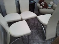 4 cream faux leather and chrome dining chairs in very good condition.