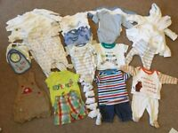 Bundle of baby clothes - new born size