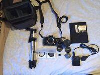 Canon 1000d DSLR w/ Canon 18-55mm + 55-250mm Lens PLUS Tripod, Bag, extras