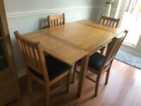 Harvey's table and chairs extendable 4 chairs