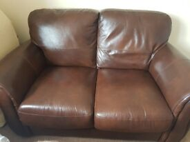 2 seater brown leather sofa in good condition for sale