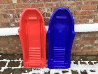 Two large plastic sledges