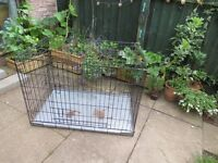 Large dog cage. Used dog crate.