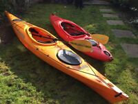 2 kayaks with paddles for sale