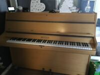 Upright Piano, fully working, slight cosmetic damage to one corner.
