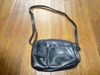 barely used small black leather effect multi pocket handbag with shoulder strap