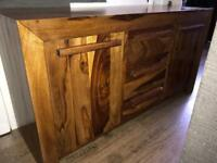 Large solid wood sideboard.