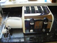 Russell Hobbs Toaster and hand mixer, both new, I will post at cost,