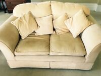 Laura Ashley two seater sofa in golden fabric.