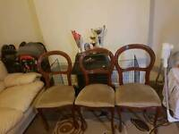 4 cushioned chairs