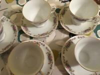 5 cups and saucers.