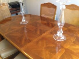French polished dining table with 6 matching chairs, two of which are carvers.