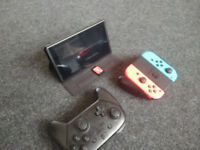 Nintendo switch with pro controller and three games