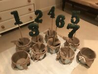 Moss Wedding Table decoration numbers with favour buckets