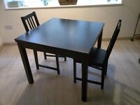 IKEA Bjursta extendable dining table with 2 chairs