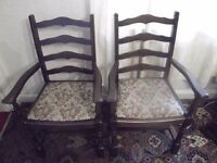 8 wooden dining room chairs, 2 with arms in good condition