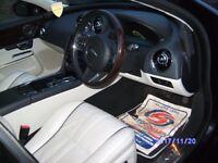 Black Jaguar XJ Portfolio LWB first reg 01/14.