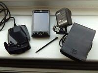 Photosmart HP iPAQ Pocket PC 2003 Pro with accessories.
