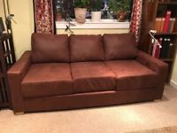 Free double sofa bed in good condition. Faux soft brown leather. Buyer to dis-assemble and pickup.