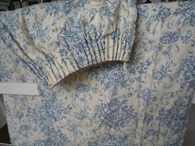 Fully lined, heavy cotton curtains in cream and blue decorative floral patttern.