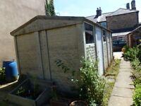 Concrete sectional garage, electric door, walk in side door, 2 windows