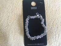 M&S Bracelet for collectable charms .Brand new and tagged