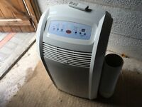Pro Line Portable Air Conditioner/Dehumidifier/Fan With Remote And Hose
