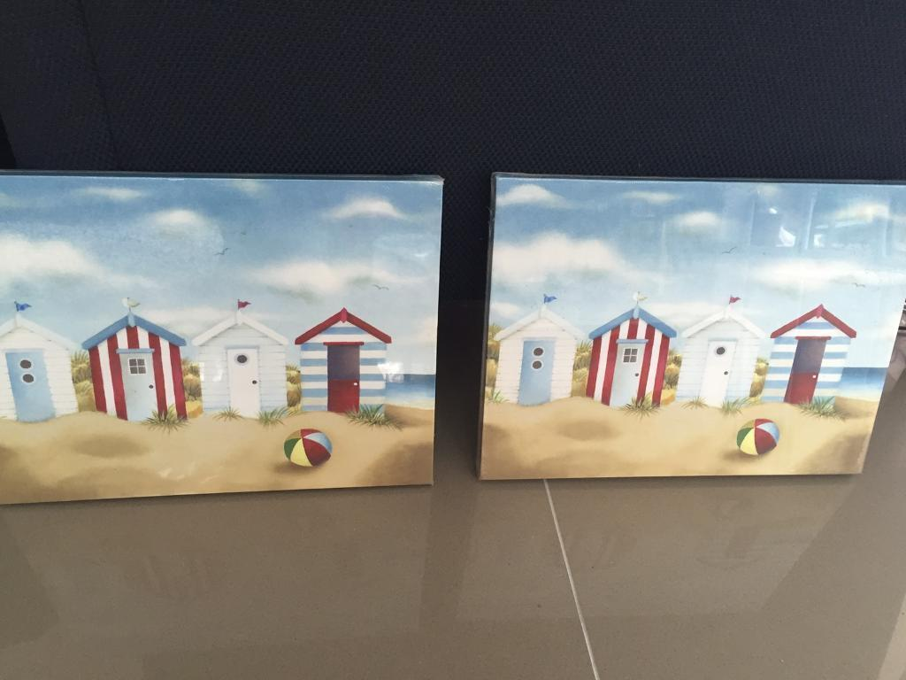 2 small charming beach hut pictures