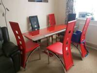 Very sturdy glass extendable dining table with 6 chairs