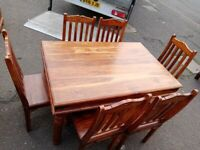 Wooden dining table + 6 chairs