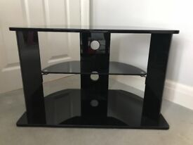 Stylish black glass TV stand in excellent condition. £45 ONO