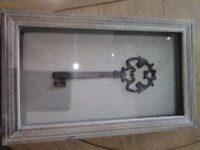 Rustic frame with hessian backing and large key