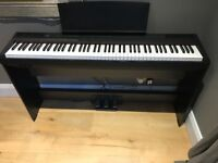 Yamaha digital piano P-105 with stand/pedal board. Excellent condition, less than 3 years old.