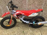 Brand new Honda child's motorbike bije