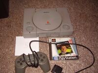PLAYSTATION 1 WITH GAME AND NEW AV LEAD SO WILL PLAY ON NEW TVS
